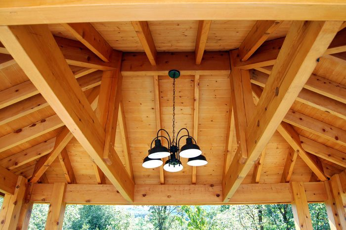 timber frame pavilion with outdoor lighting