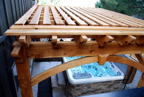 shade timber frame dovetail pergola over outdoor hot tub