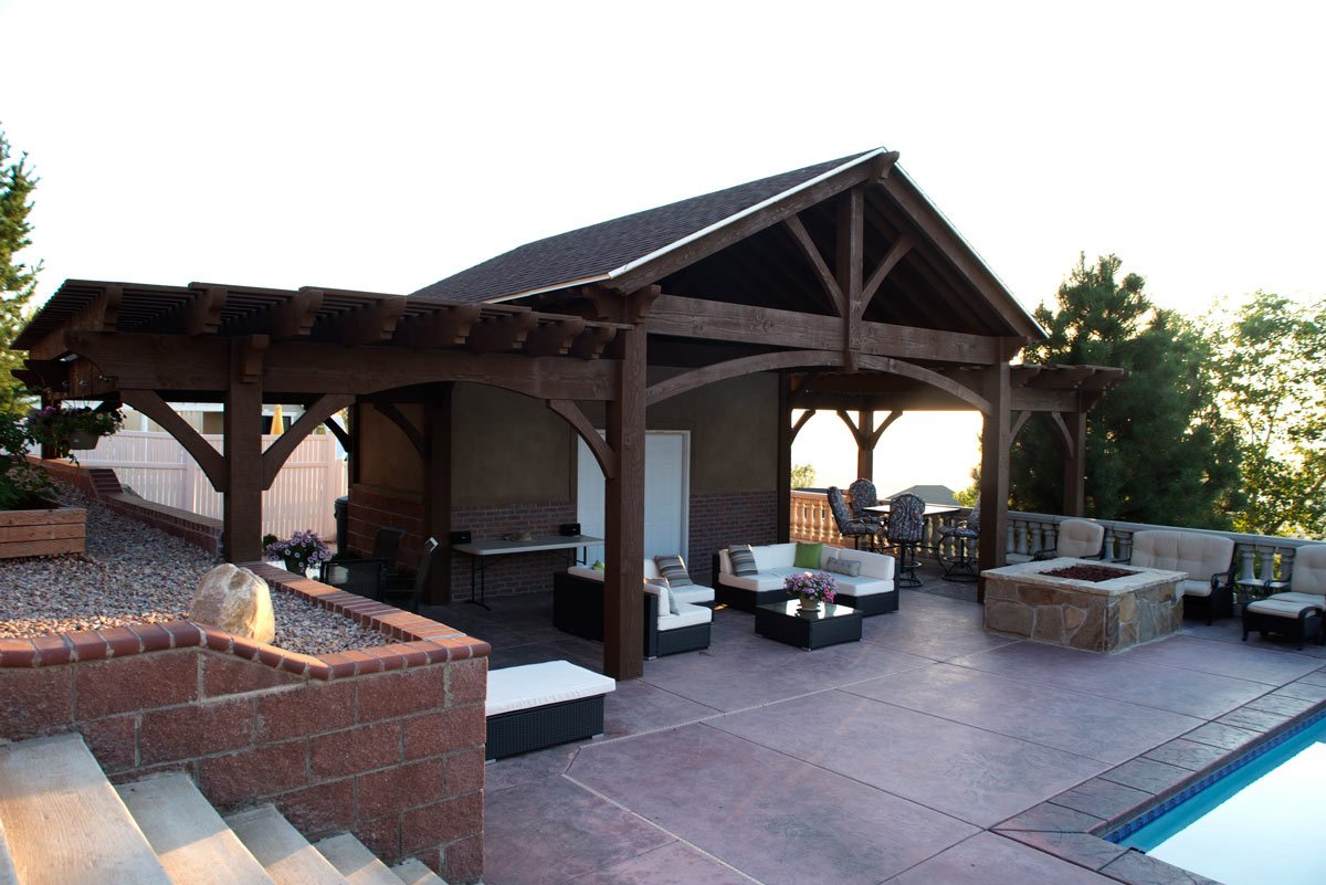 Timber frame attached pavilion with 2 pergolas for pool side shade.