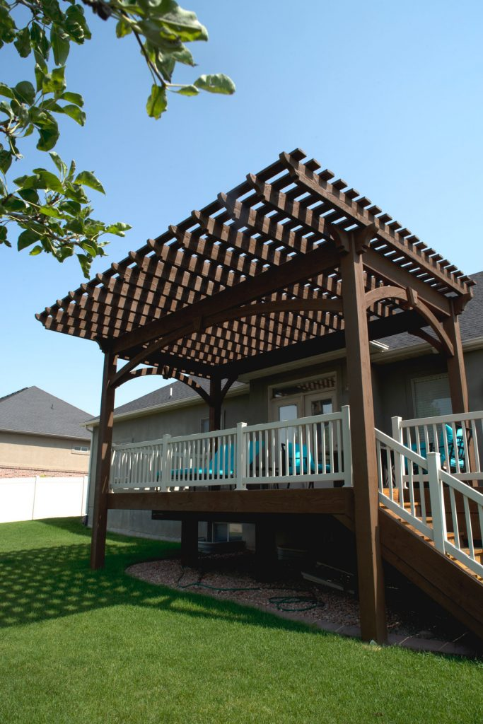 Pergola Cantilever Roof Extends Shade Beyond Backyard Deck