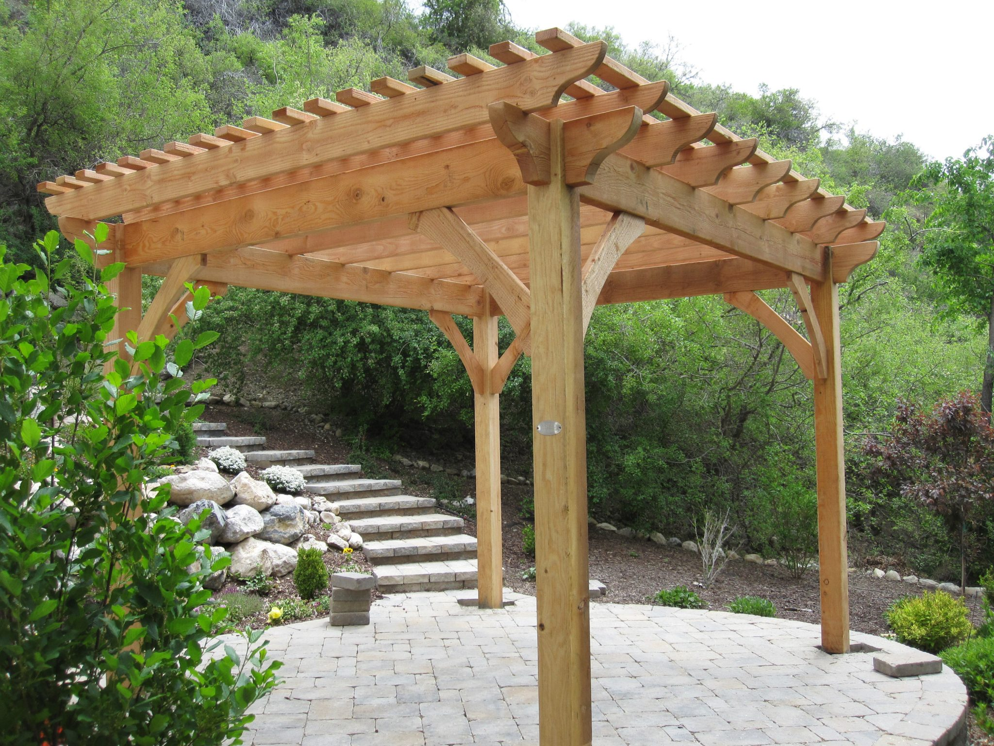 Adding shade with a natural finish timber frame pergola