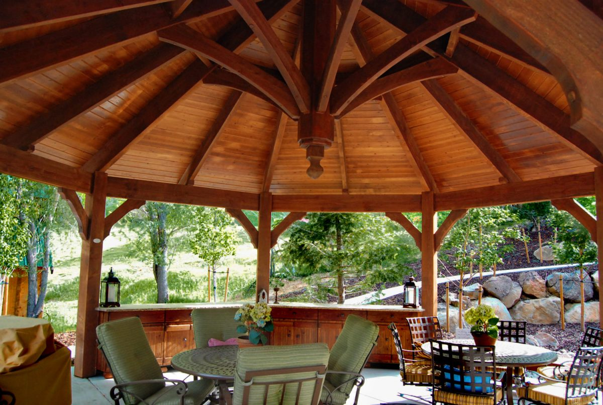 timber framed gazebo with outdoor furniture