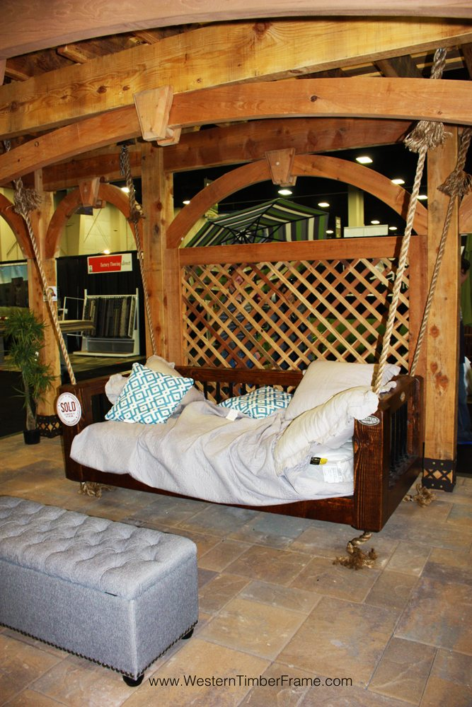 hanging solid wood bed on shade structure