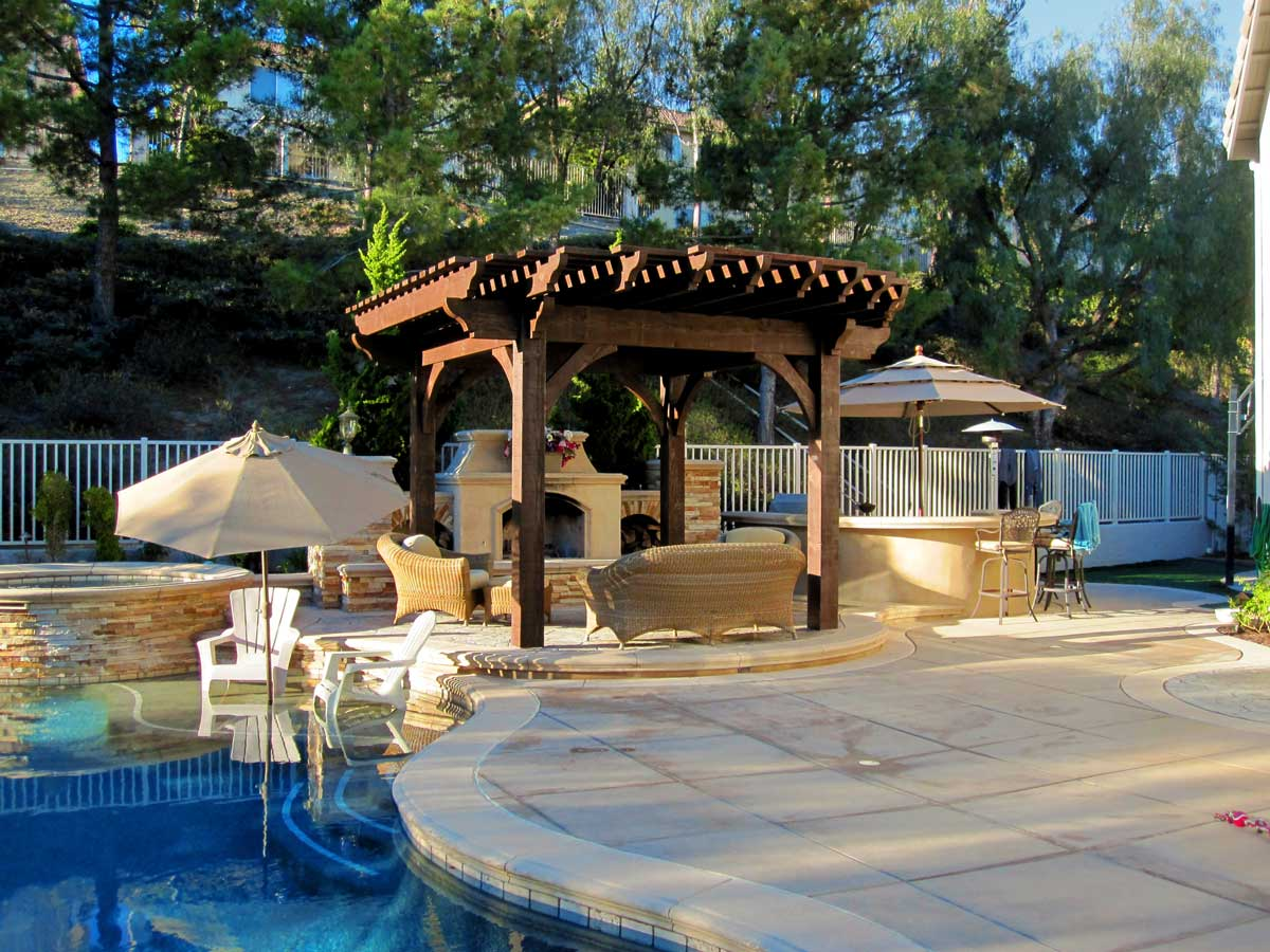 outdoor fireplace poolside pergola shade timber frame