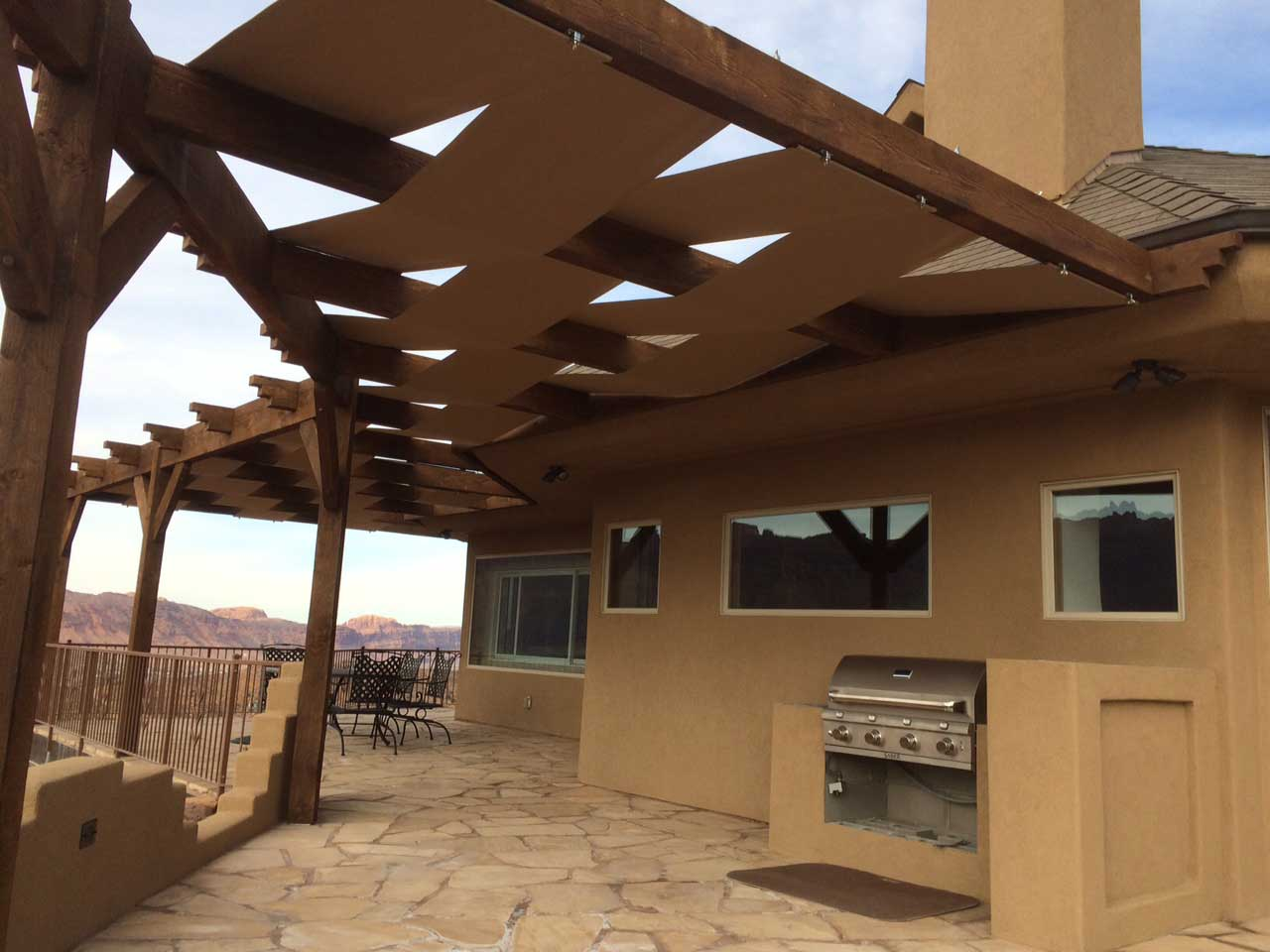 attached pergola custom outdoor kitchen