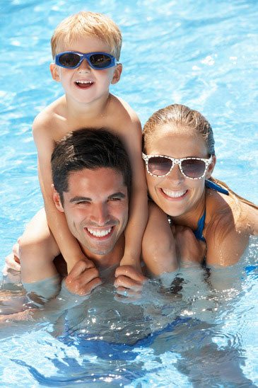 family-having-fun-in-swimming-pool-xs