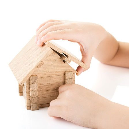 child-hands-build-house