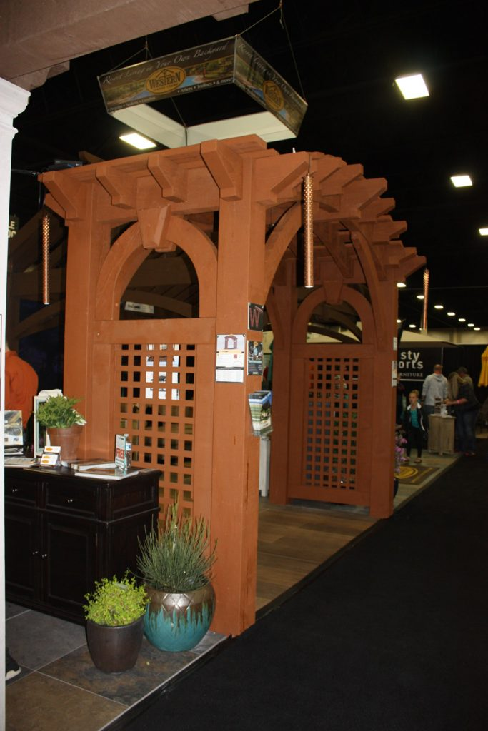 Arched timber frame arbor with trellises
