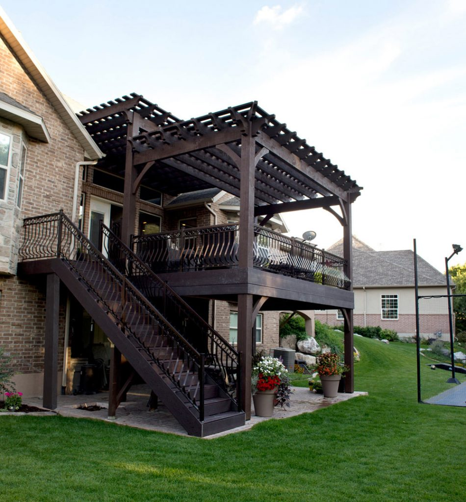 Timber frame deck with two tiered pergolas