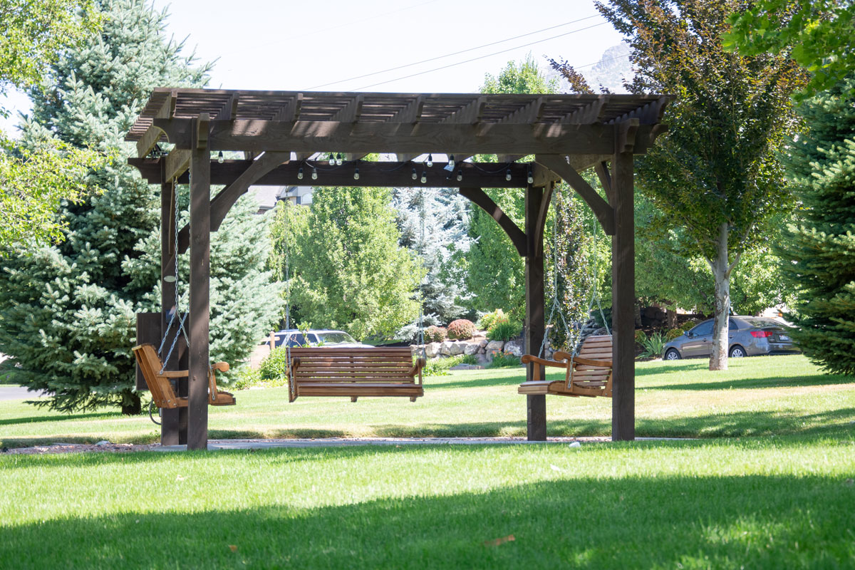 park pergola bench swings