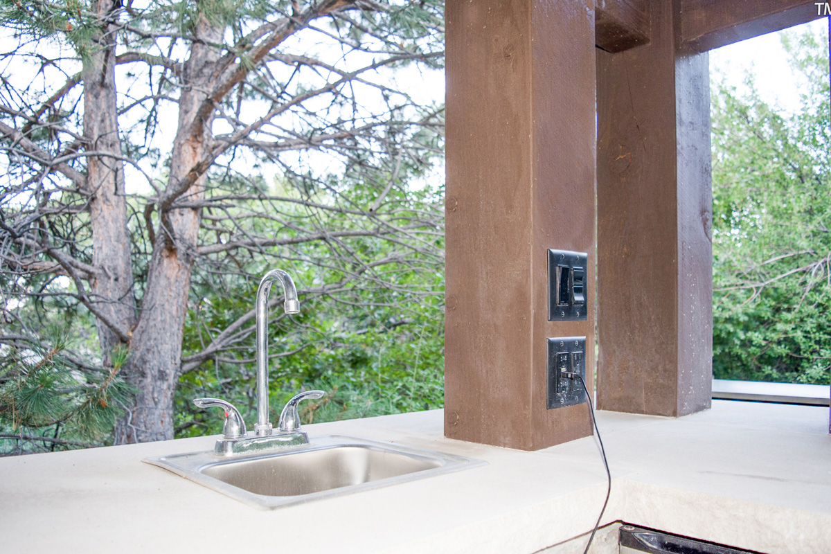 outdoor kitchen sink and integrated power post