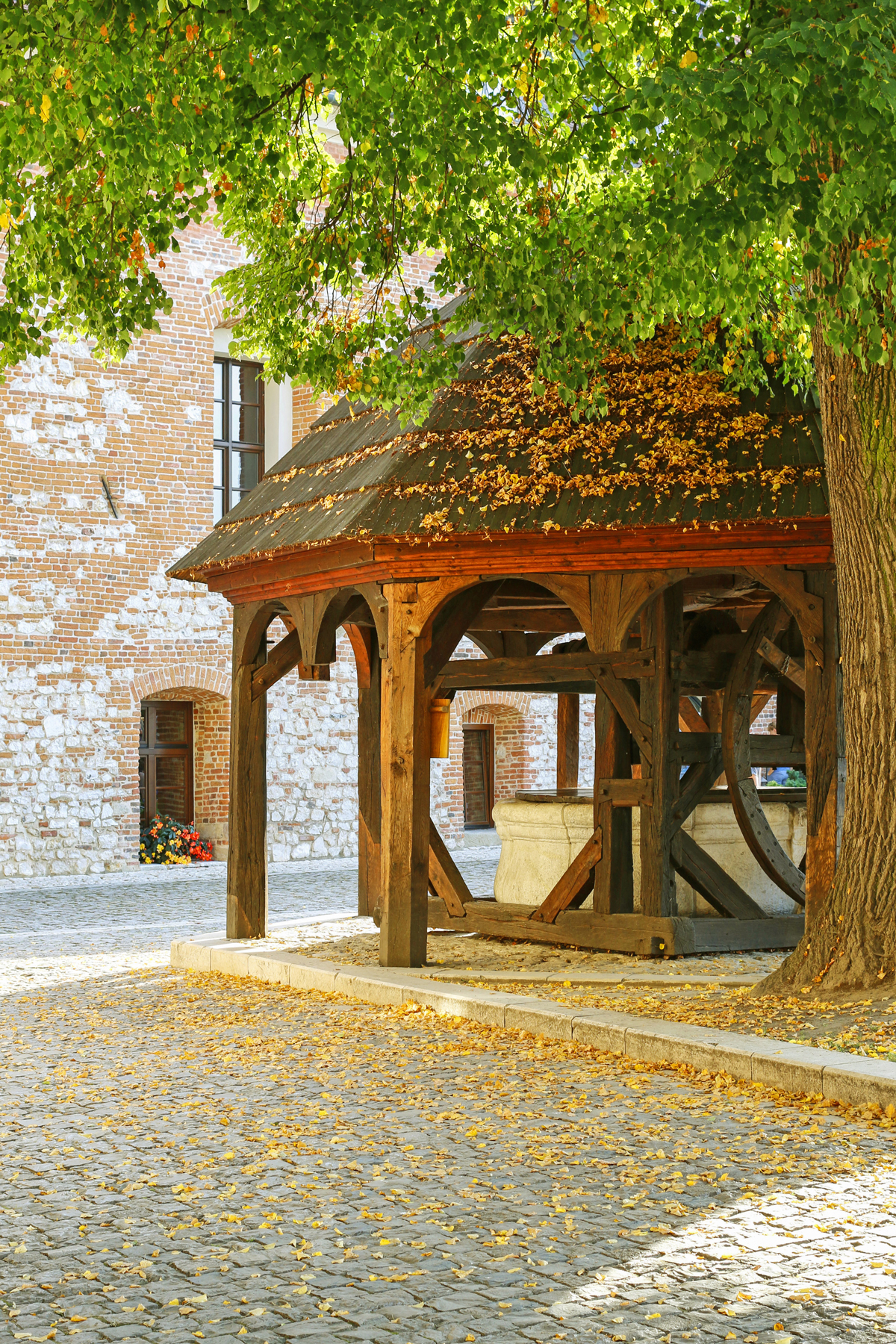 ancient wooden well Benedictine Abbey Tyniec