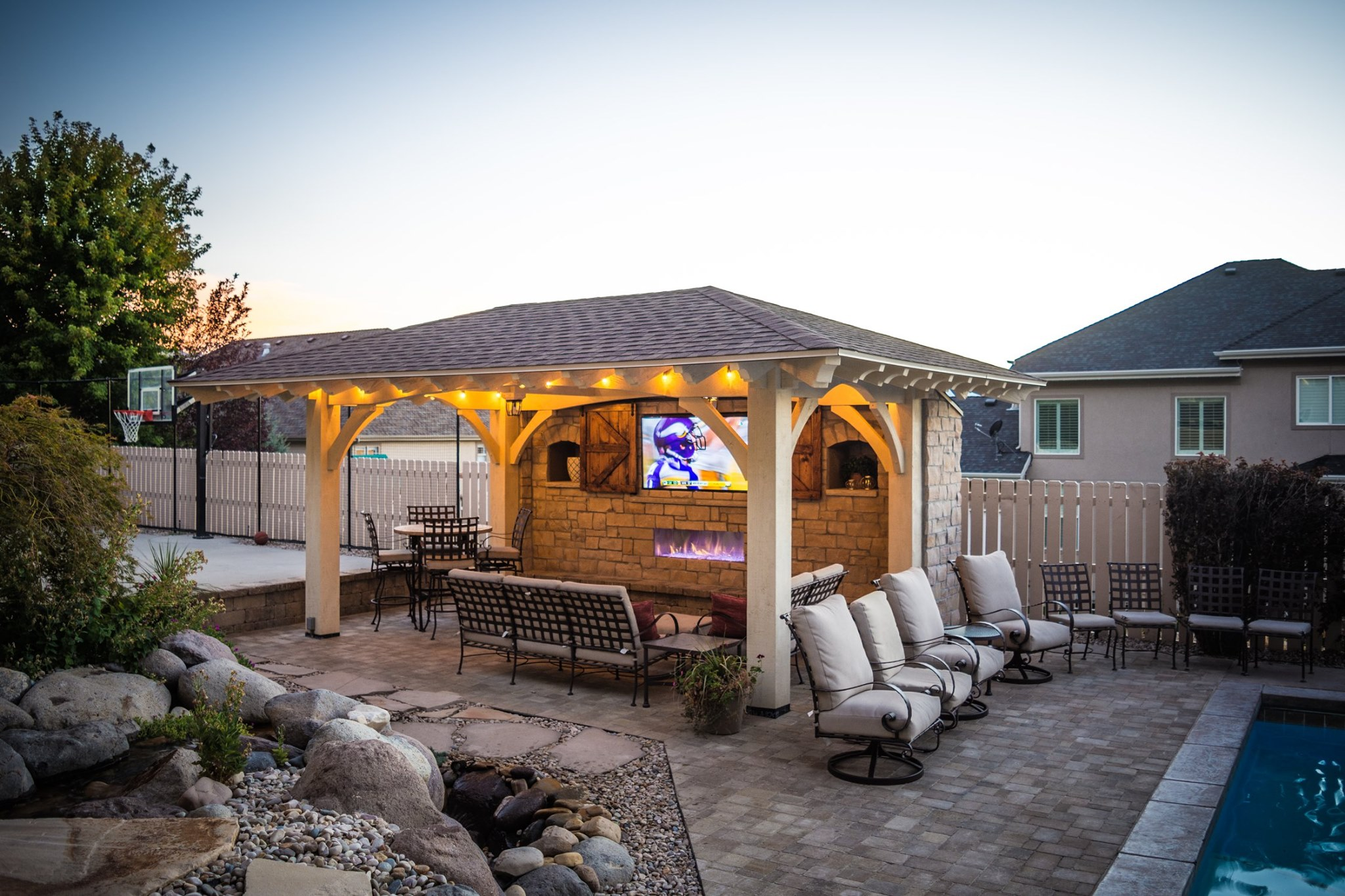 pavilion kit with tv and pool outdoor dining